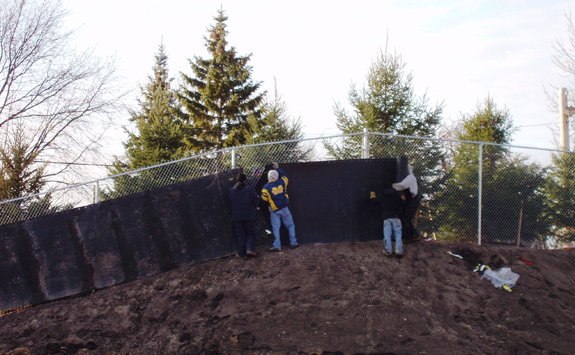 crew installing acoustifence noise barrier