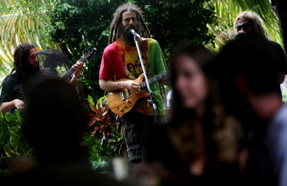 Reggae band Rebel Alliance plays live on the Guanabanas Acoustifence-lined stage